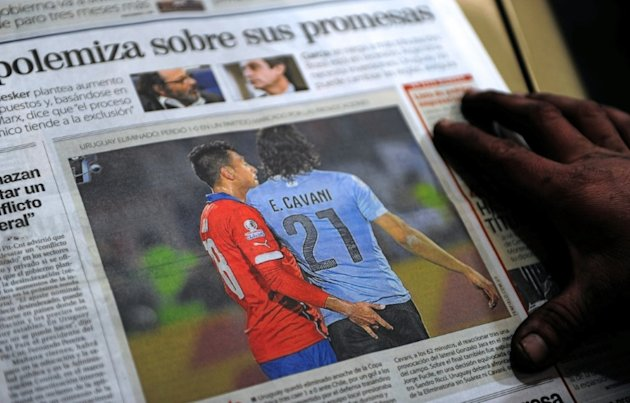 The front page of an Uruguayan newspaper shows photo of Chile's defender Gonzalo Jara provoking Uruguay's Edinson Cavani during their Copa America quarter-final match in Santiago on June 24, 2015