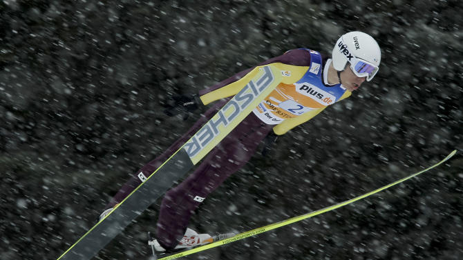 France's Nicolas Mayer competes during the FIS Men's Ski Jumping Team World Cup at Oberstdorf, southern Germany, on February 19, 2012. AFP PHOTO / GUENTER SCHIFFMANN (Photo credit should read GUENTER SCHIFFMANN/AFP/Getty Images)