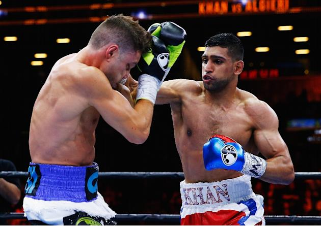 Amir Khan lands a right on Chris Algieri during their Welterweight bout at Barclays Center of Brooklyn on May 29, 2015 in New York City
