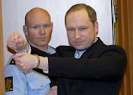 Norwegian right-wing extremist Anders Behring Breivik (right), 32, arrives on February 6 at a court in Oslo for a hearing on his detention. Breivik, who is set to go on trial on April 16 for killing 77 people in Norway last July, said in a letter published Wednesday that being sentenced to psychiatric care would be the worst fate imaginable