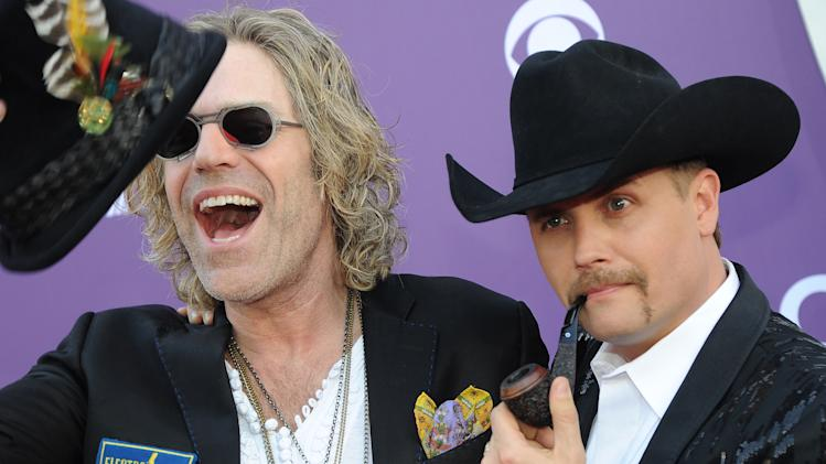 Big Kenny, left, and John Rich, of musical duo Big & Rich, arrive at the 48th Annual Academy of Country Music Awards at the MGM Grand Garden Arena in Las Vegas on Sunday, April 7, 2013. (Photo by Al Powers/Invision/AP)