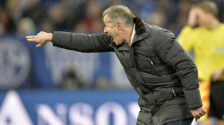 Schalke head coach Jens Keller shouts to his team from the line during the German Bundesliga soccer match between FC Schalke 04 and SV Hannover 96 in Gelsenkirchen,  Germany, Sunday, Feb. 9, 2014