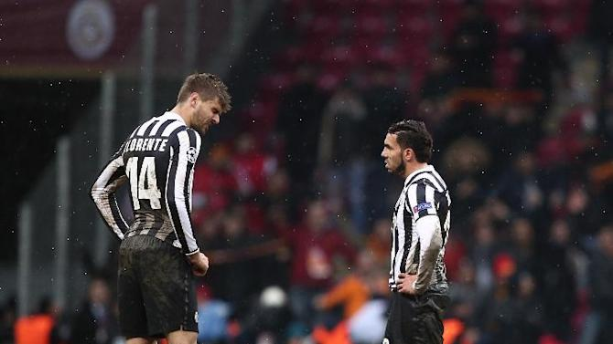 Juventus players react after losing their Champions League soccer match against Galatasaray at the TT Arena Stadium in Istanbul, Turkey, Wednesday, Dec. 11, 2013. The match was halted Tuesday in the 31st minute with the score at 0-0 as hail and snow began to fall heavily in Istanbul, but resumed Wednesday. (AP Photo)