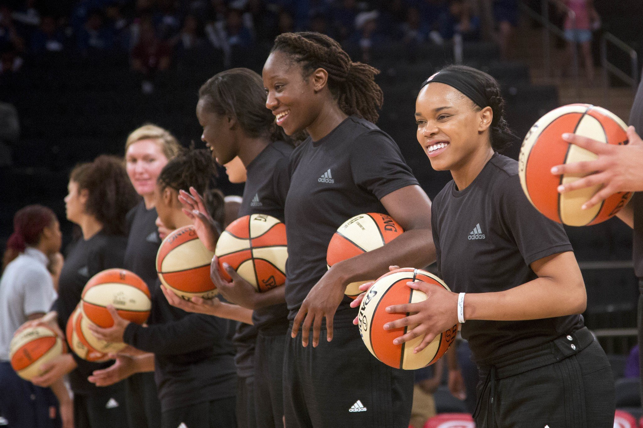 Members of the New York Liberty await the start of a game against the Atlanta Dream on July 13, 2016. (AP/Mark Lennihan, File)
