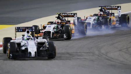 Massa of Brazil drives ahead of Hulkenberg of Germany and Perez of Mexico during the Bahrain F1 Grand Prix at the Bahrain International Circuit (BIC) in Sakhir