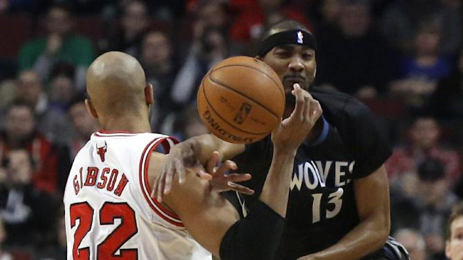 Minnesota Timberwolves forward Corey Brewer (13) knocks the ball from the hands of Chicago Bulls forward Taj Gibson (22) during the first half of an NBA basketball game, Monday, Jan. 27, 2014, in Chicago