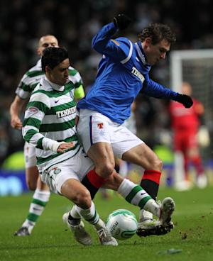 Beram Kayal, left, has backed the decision to send Rangers into Division Three