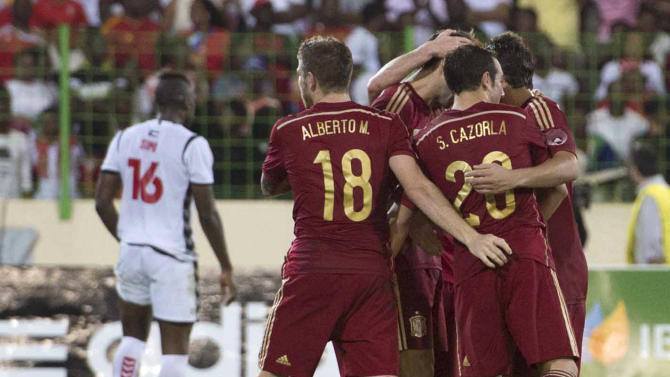 Spain's Juanfran celebrates with team mates after scoring against Equatorial Guinea during a friendly soccer match at Malabo Stadium in Malabo, Equatorial Guinea, Saturday, Nov. 16, 2013