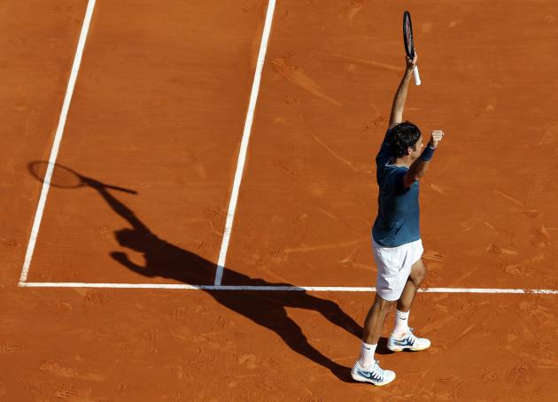 Federer of Switzerland celebrates after defeating Djokovic of Serbia during their semi-final tennis match at the Monte Carlo Masters in Monaco