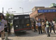 A police vehicle carrying four men accused of the gang rape of a 23-year-old woman on a bus on December 16, enters a court in New Delhi September 10, 2013. REUTERS/Adnan Abidi