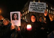 Protestors hold pictures of Indian Savita Halappanavar as they gather outside Leinster House during a demonstration in favour of abortion legislation in Dublin, Ireland. Ireland's tough abortion laws came under fire on Wednesday following the death of an Indian woman after doctors allegedly refused her a termination because it was against the laws of the Catholic country.