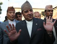 Former Nepalese monarch Gyanendra Shah (centre) attends an event in Kathmandu, on October 8, 2010. Dozens of students have staged a rare protest against Nepal's former king at the start of his private pilgrimage in the southeast of the country, police told AFP