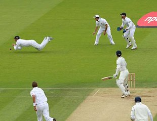 Swann drops Dravid in the slips.