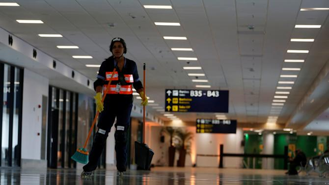 A worker skates along the new terminal at the international airport Galeao, which is expected to receive 1.5 million passengers during the Olympic Games, during its opening ceremony in Rio de Janeiro