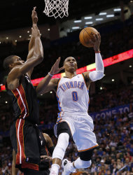 Oklahoma City Thunder guard Russell Westbrook (0) shoots in front of Miami Heat center Chris Bosh (1) during the third quarter of an NBA basketball game in Oklahoma City, Thursday, Feb. 20, 2014. Miami won 103-81. (AP Photo/Sue Ogrocki)