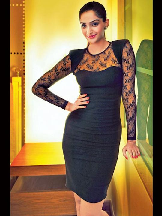 Images via : iDiva.comSonam Kapoor wears a well-tailored black dress with lace on the sleeves and neck.Related Articles - Vote: Shilpa Shetty Vs Sridevi in One-Shoulder Dresses5 Ways to Jazz Up an LBD