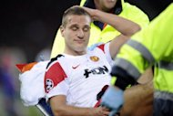 Manchester United's Nemanja Vidic is stretchered off after injury during their UEFA Champions League group C football match against Basel in December 2011 in Basel. Vidic will miss the next eight weeks after undergoing surgery on a knee injury, the Premier League club has announced