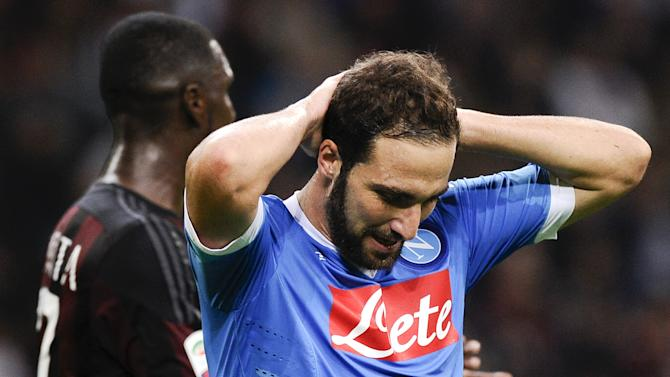 Napoli's Higuain reacts during their Italian Serie A soccer match against AC Milan at the San Siro stadium in Milan