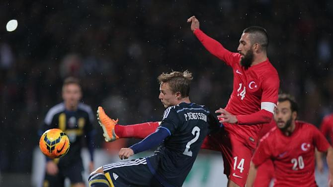 Turkey's Arda Turan, right, vies for the ball with Sweden's Pierre Bengtsson during their International Friendly soccer match at 19 Mayis Stadium in Ankara, Turkey, Wednesday, March 5, 2014.(AP Photo)
