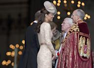 Kate, Duchess of Cambridge talks to religious leaders as she arrives at St Paul's Cathedral for a national service of thanksgiving for the Britain's Queen Elizabeth II and her Queen's Diamond Jubilee in London, Tuesday, June 5, 2012. (AP Photo/Alastair Grant)
