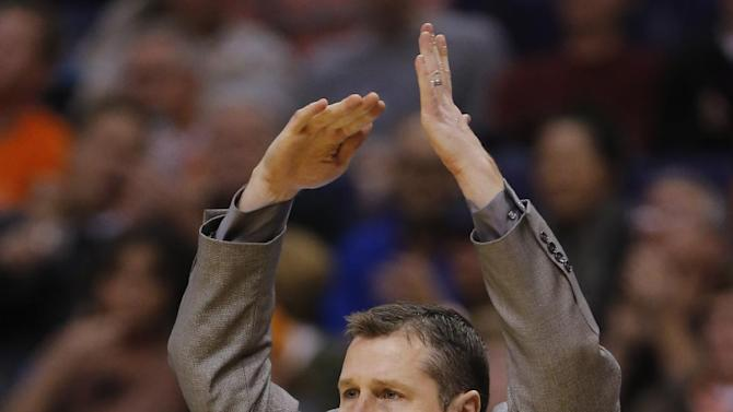 Memphis Grizzlies head coach David Joerger calls a timeout against the Phoenix Suns during the second half of an NBA basketball game on Thursday, Jan. 2, 2014, in Phoenix. The Grizzlies won 99-91