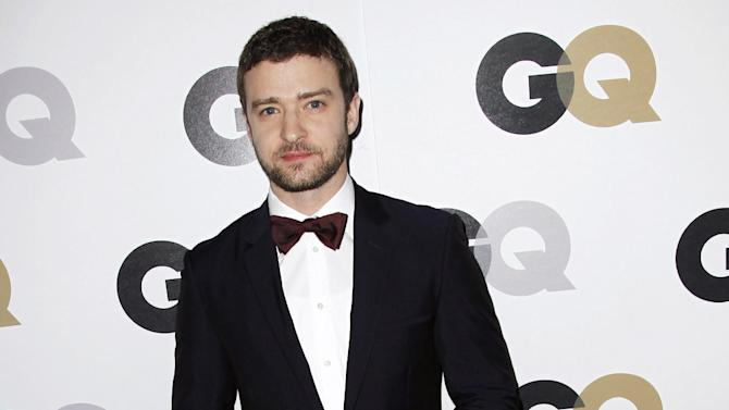 "FILE - This Nov. 17, 2011 file photo shows Honoree Justin Timberlake arrives at the 16th annual GQ ""Men of the Year"" party in Los Angeles, Thursday, Nov. 17, 2011. The lyric video _ which features words onscreen while a song plays _ is not a new phenomenon in music. But these days, lyric videos are used to promote new songs, giving fans something to hold on to between a song's release and the launch of an official music video.Timberlake  recently released a lyric video for his new single, ""Suit & Tie.""  (AP Photo/Matt Sayles)"