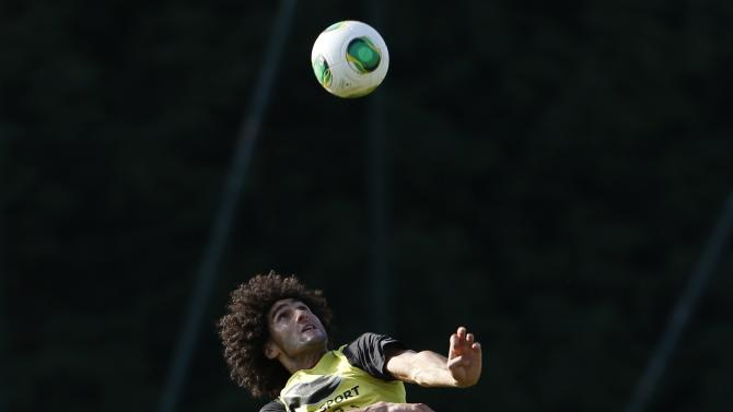 Belgium national soccer team player Fellaini heads a ball during a training session in Brussels