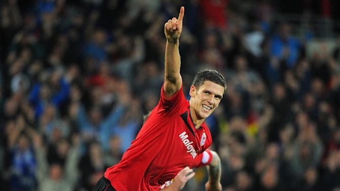 Mark Hudson scored the winning goal taking Cardiff to top of the Championship