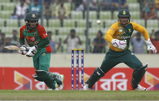 Bangladesh's Mushfiqur Rahim, left, plays a shot, as South Africa's wicketkeeper Quinton de Kock follows the ball during the first Twenty20 international cricket match against South Africa in Dhak