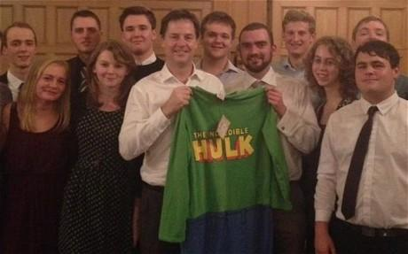 Gift: Nick Clegg shows off the onesie he was given in Sheffield (Harry Matthews)