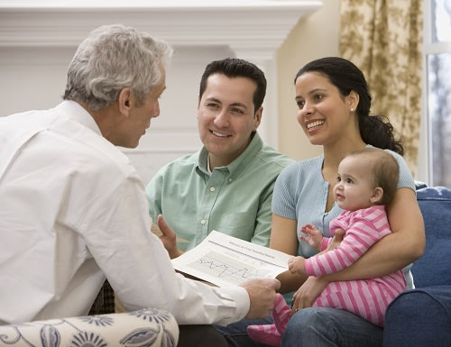 Hispanic family talking with financial advisor
