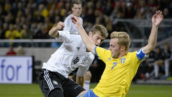 Sweden's Sebastian Larsson, right, vies with Germany's Toni Kroos during the 2014 World Cup group C qualifying soccer match between Sweden and Germany at Friends Arena in Stockholm, Sweden, Tuesday, Oct. 15, 2013