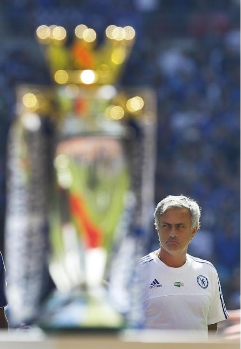 Chelsea's manager Jose Mourinho is seen behind the Premiership Trophy as it is displayed on the pitch ahead of the English Community Shield soccer match between Arsenal and Chelsea at Wembley Stad