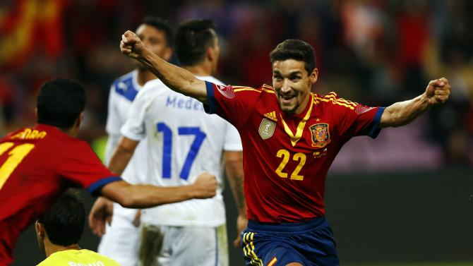Spain's Jesus Navas celebrates with teammate Pedro after scoring a goal against Chile during their international friendly soccer match at the Stade de Geneve in Geneva