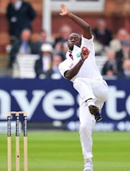 West Indies' cricketer Kemar Roach bowls during the fifth day of the first Test match against England at Lords cricket ground in London. Alastair Cook's unbeaten fifty steadied England in their victory chase after the West Indies gave the hosts a couple of scares