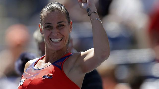 Tennis - Seeds tumble in Dubai, Pennetta shocks Radwanska