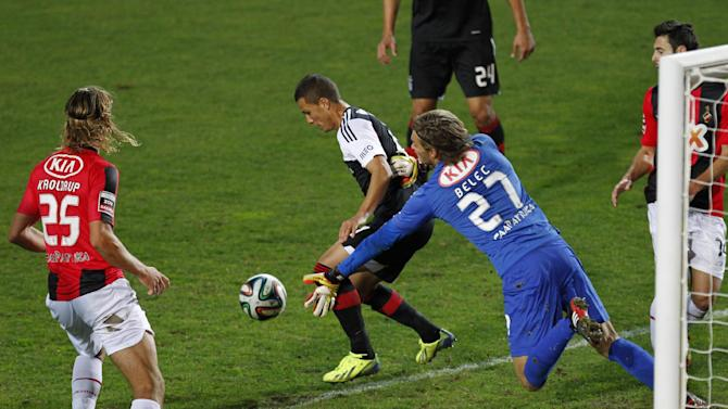 Benfica's Lima, background centre from Brazil, challenges Olhanense's goalkeeper Vid Belec, second right, from Slovenia, during a Portuguese league soccer match between Benfica and Olhanense at the Algarve stadium in Faro, southern Portugal, Sunday, Dec. 15, 2013. Lima scored once in Benfica's 3-2 victory