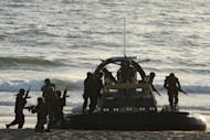 File photo shows Pakistan naval commandos in action during a naval exercise on the outskirts of Karachi in March 2011. Globally the volume of international transfers of major conventional weapons was 24 percent higher in the period 2007-11 compared to the 2002-06 period