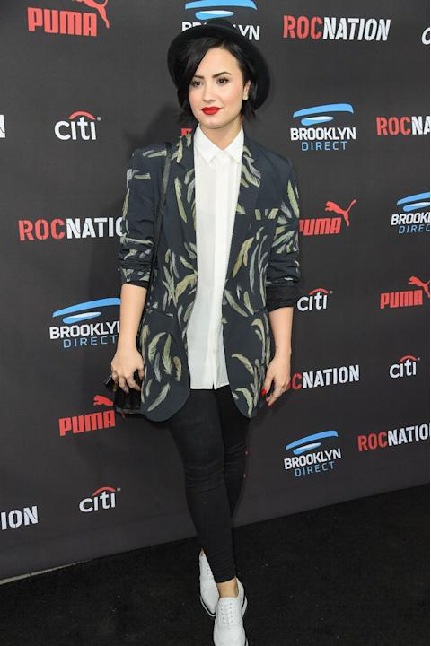 FILE - In this Feb. 7, 2015, file photo, Demi Lovato arrives at the Roc Nation Pre-Grammy Brunch at RocNation Offices in Beverly Hills, Calif. Lovato is sharing her personal story and encouraging othe