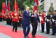 Outgoing European Commission President Jose Manuel Barroso, right, walks along the Guard of Honor as he is welcomed by Albanian Prime Minister Edi Rama in Tirana Monday, June 30, 2014. Albania was granted candidate status from the EU bloc last week. (AP Photo/Hektor Pustina)
