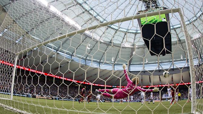 Vancouver Whitecaps goalkeeper David Ousted, of Denmark, dives to stop a Real Salt Lake shot on goal during the second half of an MLS soccer game Saturday, Sept. 28, 2013, in Vancouver, British Columbia