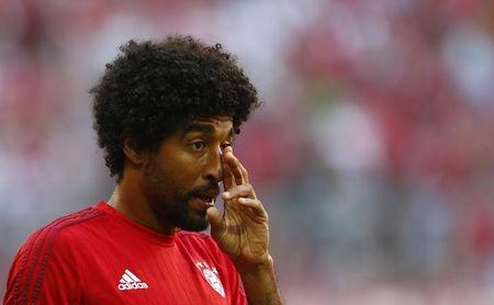 Bayern Munich's Dante wipes face before German first division Bundesliga soccer match against Bayer Leverkusen in Munich