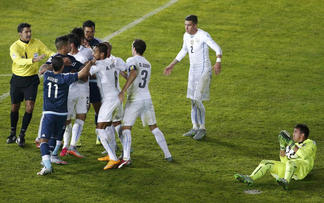 Argentina players confront players from Uruguay during their first round Copa America 2015 soccer match at Estadio La Portada in La Serena