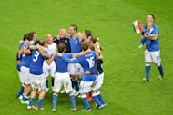 Italian players celebrate beating germany 2-1 in the semi-final of the Euro 2012 football championships June 28, at the National Stadium in Warsaw. Mario Balotelli struck twice to seal Italy's 2-1 semi-final win over Germany to leave the Germans' Euro 2012 ambitions in tatters while the Azzurri march on to the final