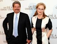 "American actress Meryl Streep (R) and director John Wells pose before a gala screening of the film ""August: Osage County"", on February 13, 2014 in Paris"