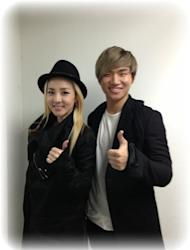 Sandara Park shows a photo taken with Dae Sung