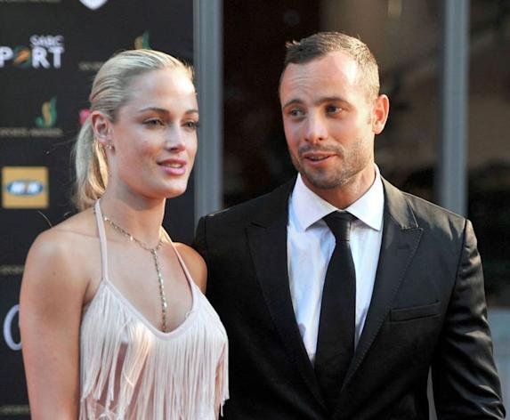 South African Olympic sprint star Oscar Pistorius and his model girlfriend Reeva Steenkamp pictured at the the Feather Awards in Johannesburg on November 4, 2012. Pistorius has been charged with the murder of Steenkamp, police confirmed on February 14, 2013 ahead of his expected court appearance