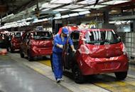 This file photo shows workers assembling a car at Chinese carmaker's Chery Automobile plant in Wuhu, east China's Anhui province, in 2011. Some 23,000 cheap Chinese-made cars, including Chery, were on Wednesday recalled in Australia after asbestos was found in their engines, with unions demanding to know how they came to be in the country