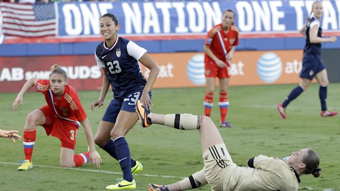United State's Christen Press (23) smiles after scoring against Russia during an international friendly soccer match in Boca Raton, Fla., Saturday, Feb. 8, 2014. The U.S. won 7-0