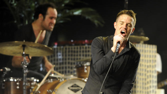 """FILE - In this April 18, 2009 file photo, Brandon Flowers of The Killers performs during the band's headlining set on the second day of the Coachella Valley Music & Arts Festival in Indio, Calif. The Killers frontman wanted to get his voice right before hitting the studio to record the band's latest album, """"Battle Born,"""" so he decided to take voice lessons. (AP Photo/Chris Pizzello, file)"""